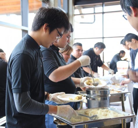 Food being doled out at the Thanksgiving Feast | Alex Chu.