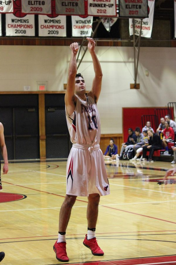 Foothill college Basketball player Alex Gil-Fernandez scores during an Nov 21st game against the   Monterey Peninsula Lobos.