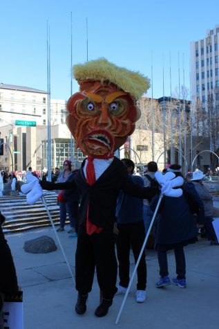 A Donald Trump costume held the center of attention at Women