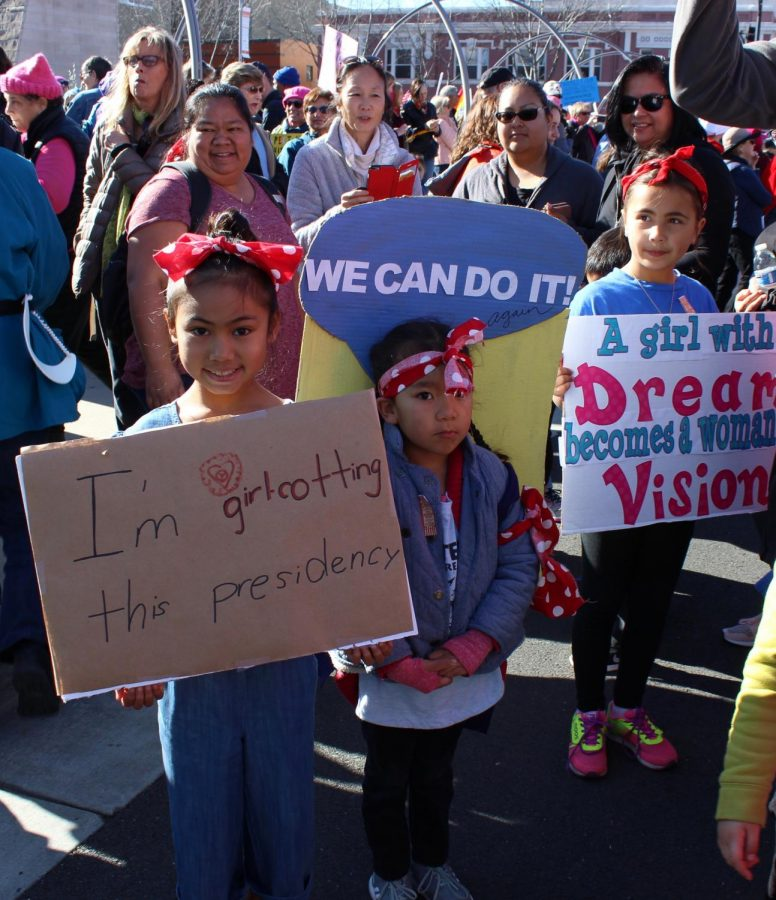 Sisters pose in costume during Women's March San Jose in 2018