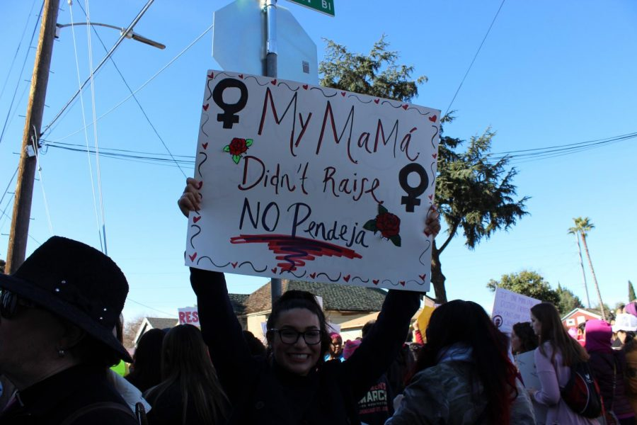 A happy marcher poses during Women's March San Jose