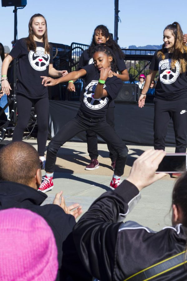 A local Bay Area, all female dance group called Mini Mix'd of girls range from middle school to high school performed at the Oakland march.