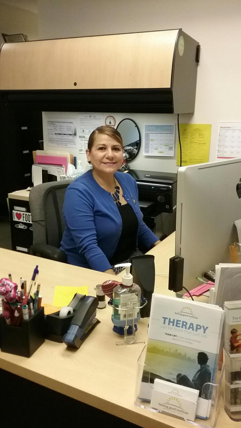 Administrative assistant, Patricia Meza Parada, diligently works at her desk in the Psychological Services and Personal Counseling Center