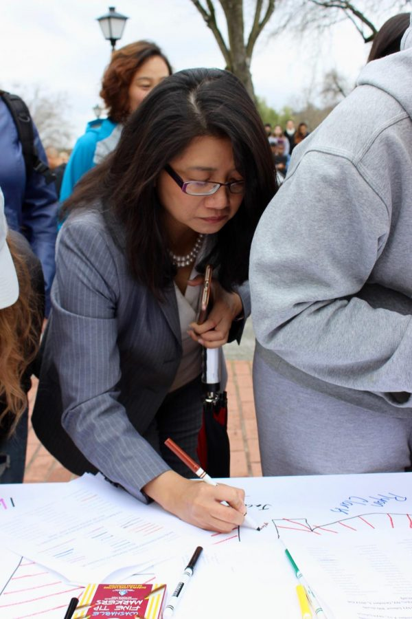 President Nguyen signs posters during a National School Walkout event at Foothill College.