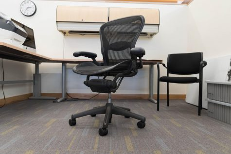 An empty rolling chair sits in an office at Foothill College.