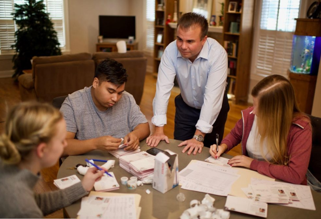 Caserta is pictured inside his campaign headquarters, his personal living room, with student volunteers.