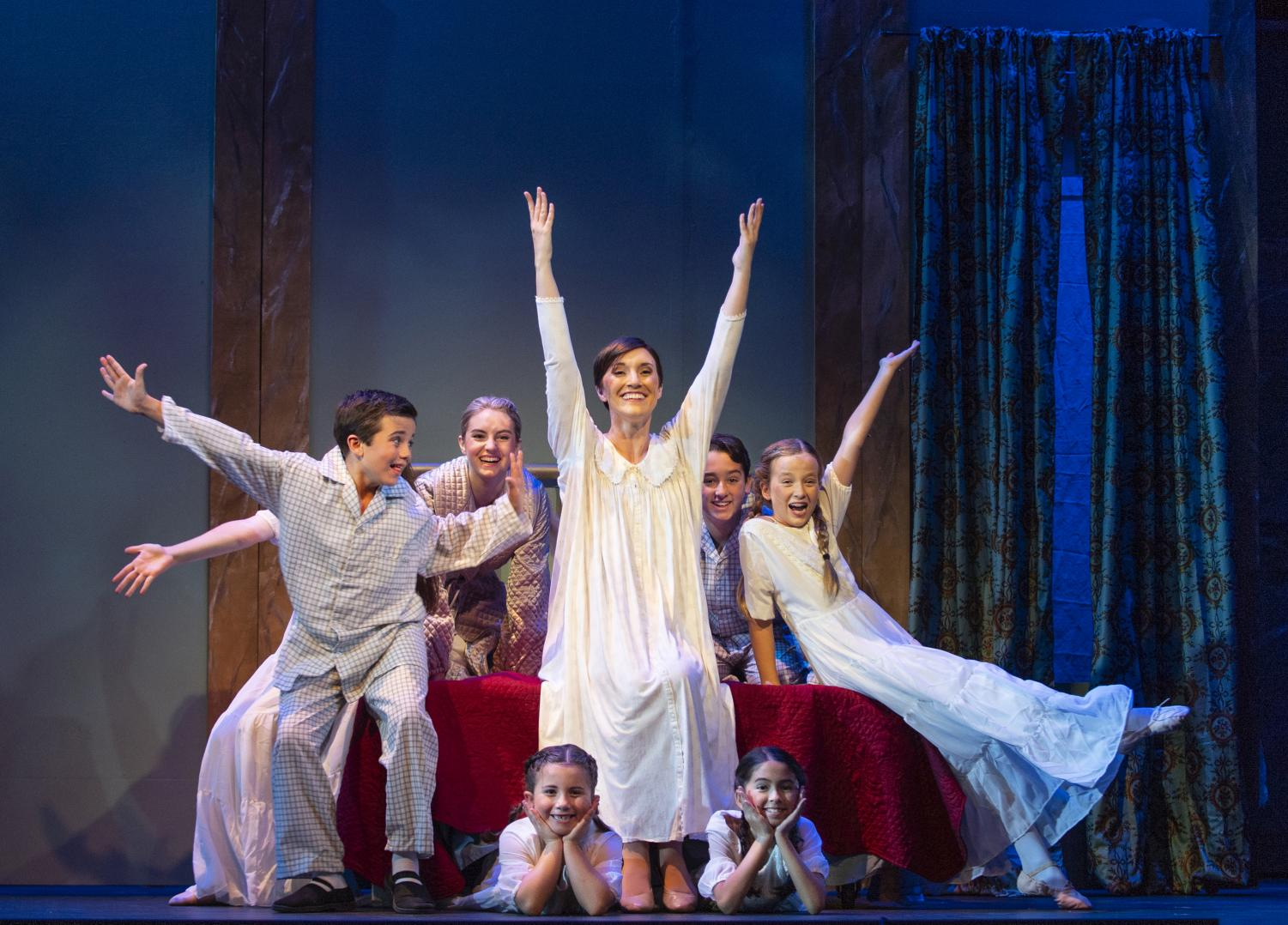 Maria (center – Jillian Bader) and the von Trapp children (clockwise from left: Billy Hutton, Madison Colgate, Jake Miller, Anna Savage, Jane Quiazon, Mary Hutton) all sing together to forget their fear of the thunder.