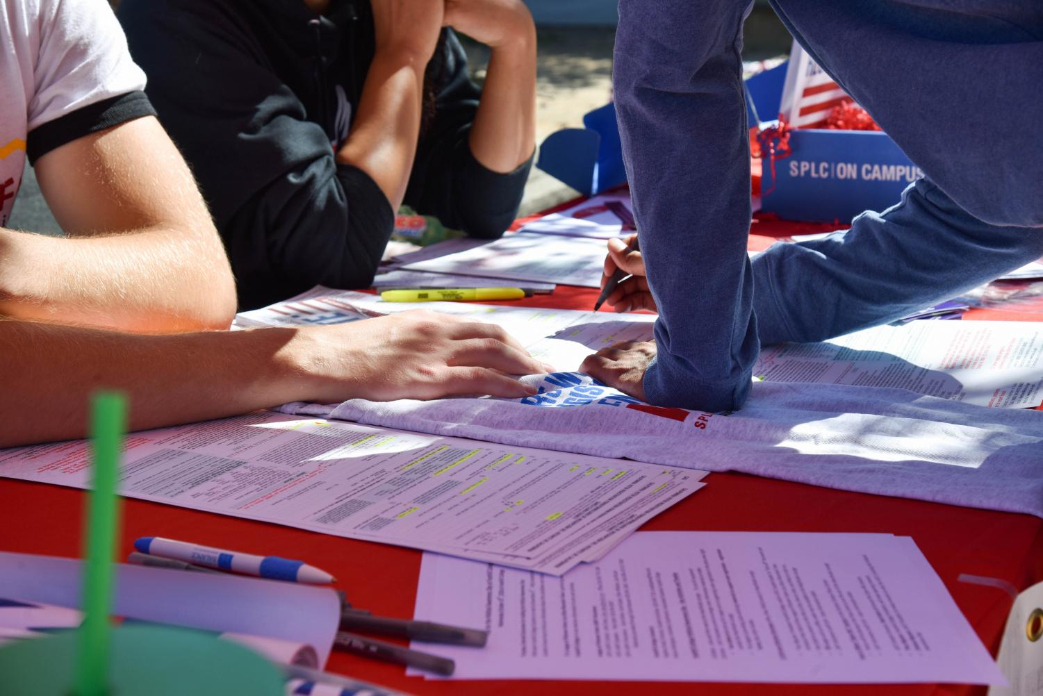 A student fills out registration papers during Political Awareness Day at Foothill College.