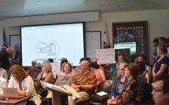 Faculty gather in protest of withheld cost-of-living adjustments at a Foothill-De Anza District meeting in June.