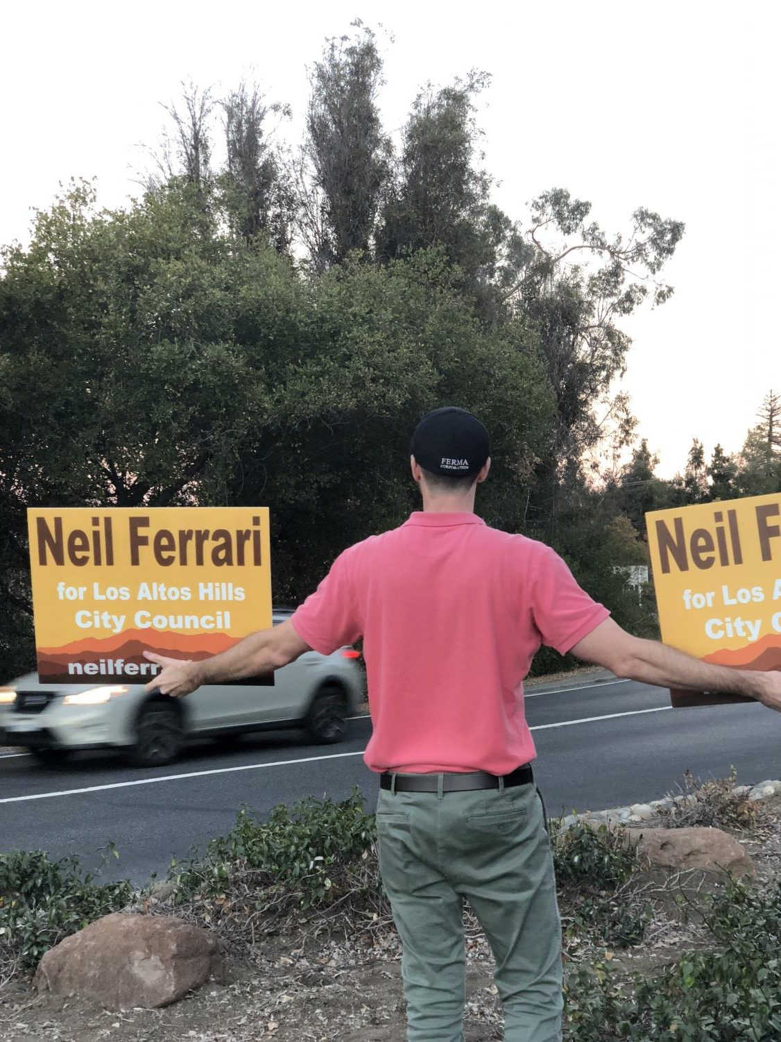Los+Altos+Hills+Candidate+Neil+Ferrari+stands+on+an+island+dividing+traffic+to+campaign+hours+before+voting+finishes.