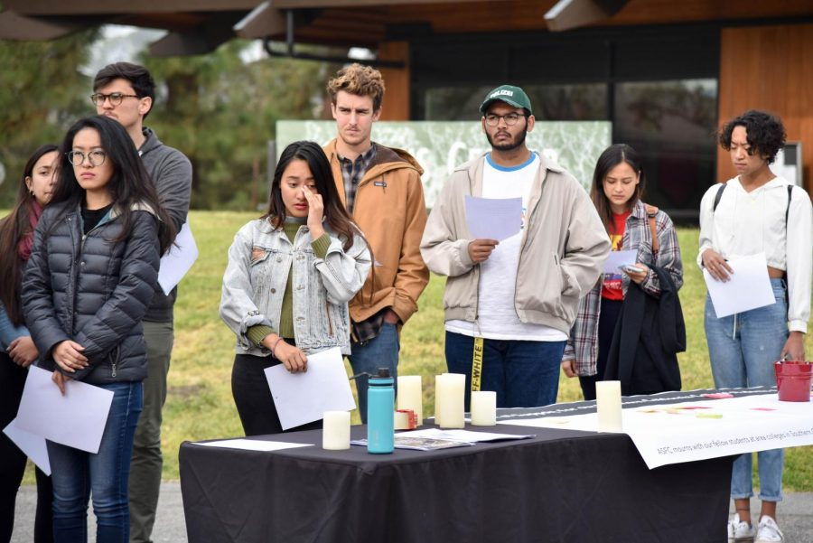 Members of the Associated Students of Foothill College prepare to share victims' biographies with others.