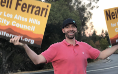Los Altos Hills Candidate Neil Ferrari stands on an island dividing traffic to campaign hours before voting finishes.