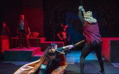Tilly, played by Fatima Mejia, attacks a monster onstage.